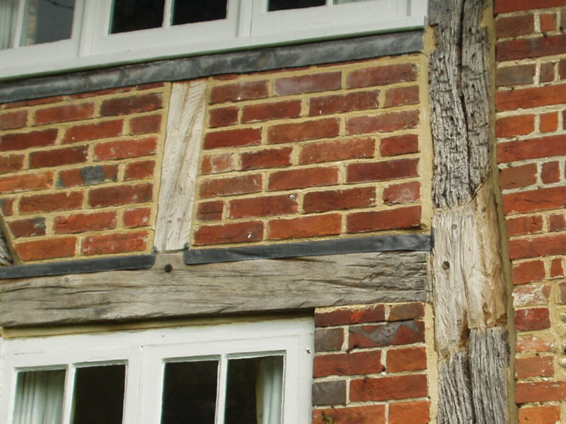 Timber frame repairs and new brick infill